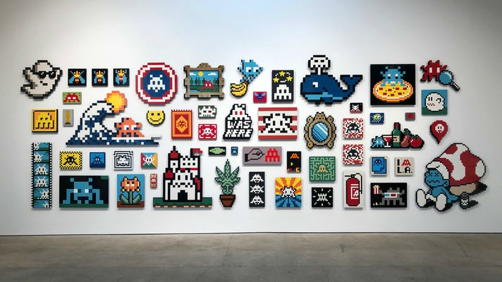 """Wall of aliases by Invader at """"Into the White Cube"""""""