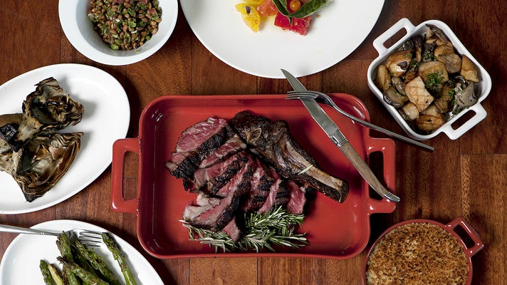 Wagyu tomahawk and sides at The Royce Wood-Fired Steakhouse