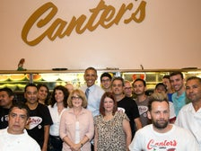 President Barack Obama poses with staff at Canter's Delicatessen