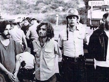 Charles Manson and two members of the Straight Satans Motorcycle Club being arrested at Spahn Ranch in August 1969