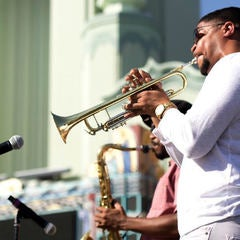 Supa Lowery Brothers perform outside the Vision Theatre in Leimert Park